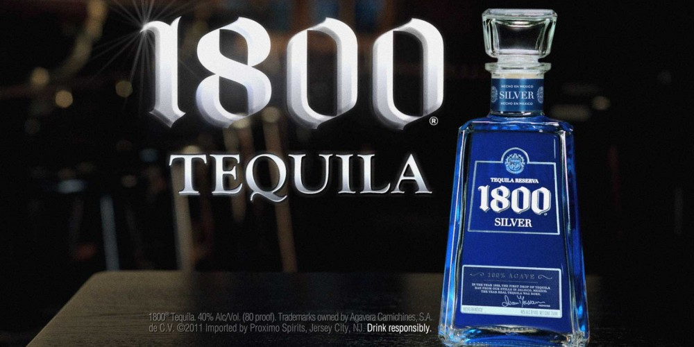 1800 Tequila Bottle silver, blue, and white