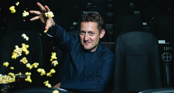 Alex Winter throwing popcorn in a theater