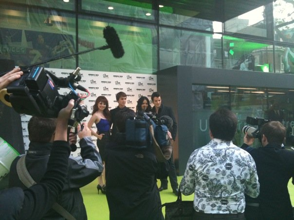 Teen cast posing for photos at the London premiere of Ben 10 Alien Swarm