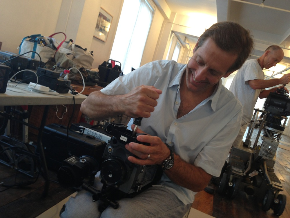 Joe Desalvo repairing movie cameras, photo by Alex Winter