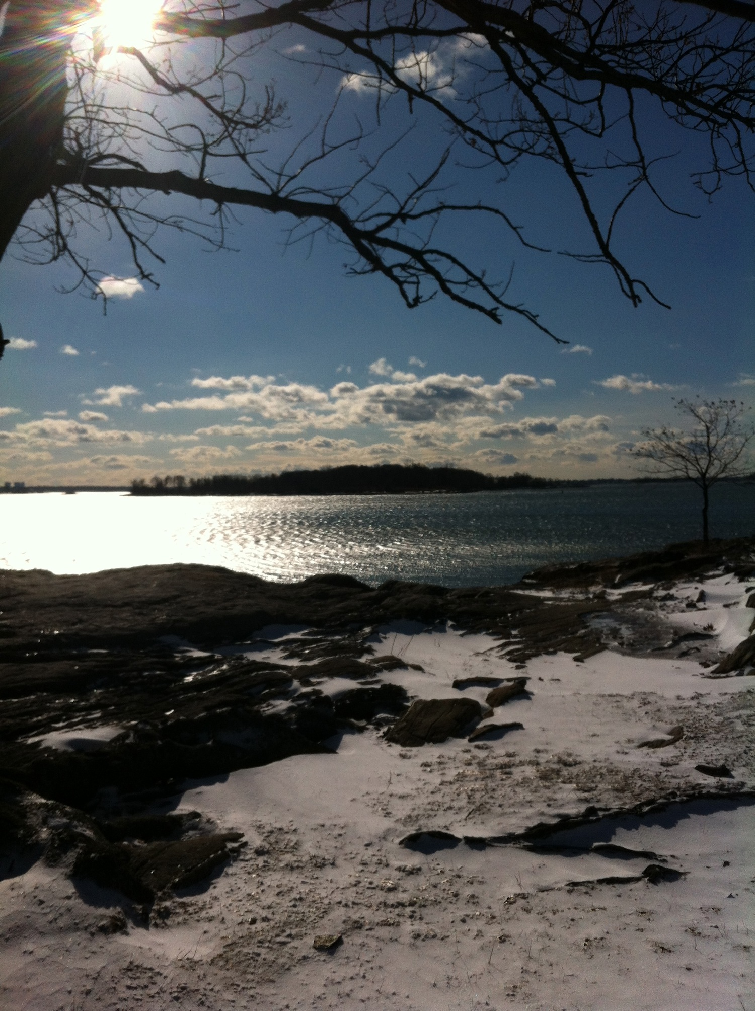 Photo by Alex Winter of a view of snow overlooking water